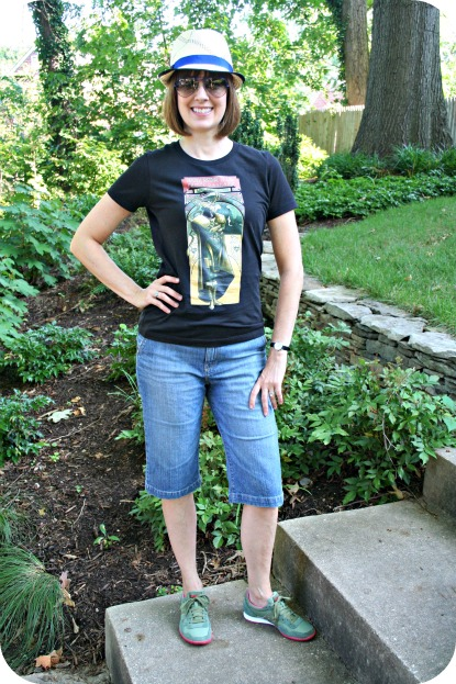 Working mom weekend casual outfit: Geek chic comic book T-shirt, denim Bermuda shorts, Saucony casual shoes, Eugenia Kim straw hat, Ray-Ban aviator sunglasses