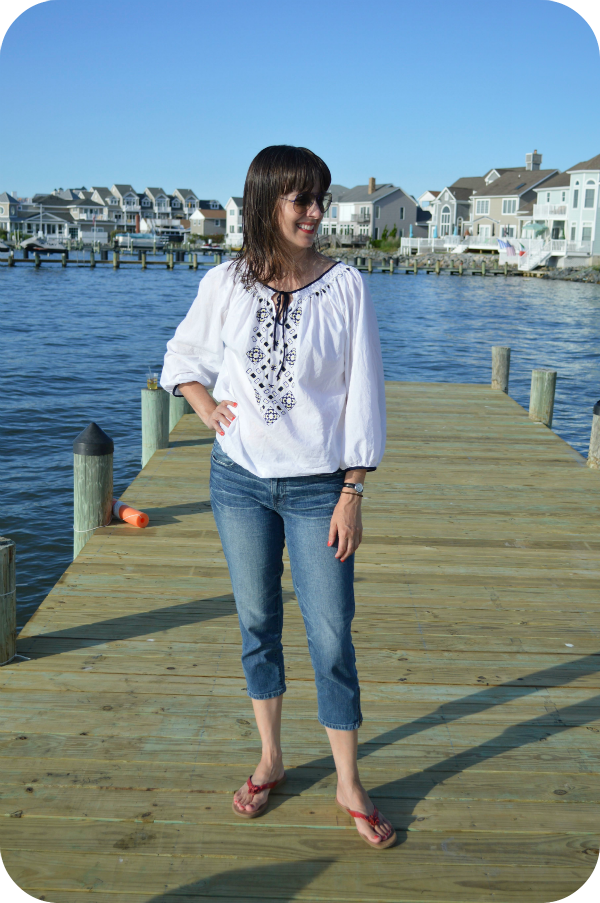 8857a8a819 Working mom beach weekend casual outfit with denim capris, peasant blouse,  red sandals